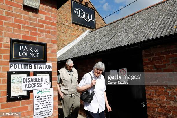A couple leave after casting their votes at The Bull pub polling station on June 06 2019 in Peterborough England Brexit Party candidate Mike Greene...