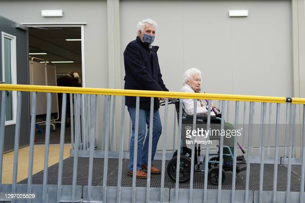 Couple leave the Askham Bar Mass Vaccination Centre in York after receiving the AstraZeneca/Oxford University covid-19 vaccination on January 18,...