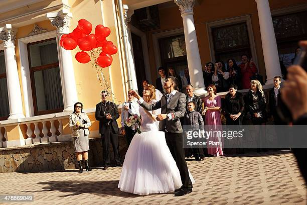Couple lets go of balloons after being married on March 15, 2014 in Simferopol, Ukraine. As the standoff between the Russian military and Ukrainian...