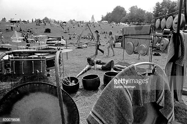 Couple lie in the grass surrounded by instruments at the Woodstock Music & Art Fair, Bethel, NY, August 15, 1969.