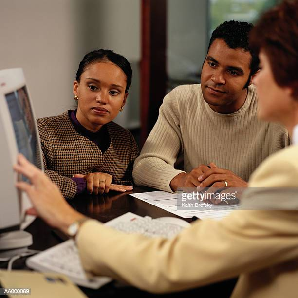 Couple Listening to Information About Home Loan