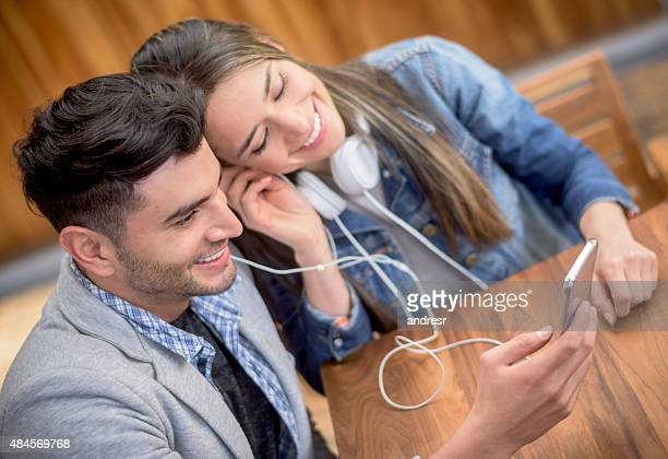 Couple listening to music with earphones