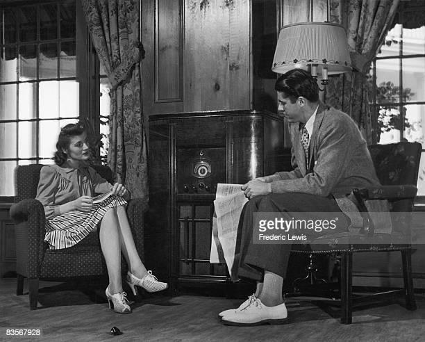 A couple listening to their radio USA circa 1940