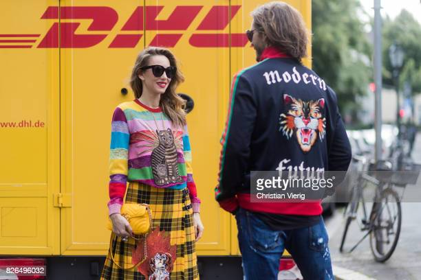Couple look a like talking and flirting in front of DHL van Model and Blogger Alexandra Lapp wearing a yellow and red pleated tartan skirt...