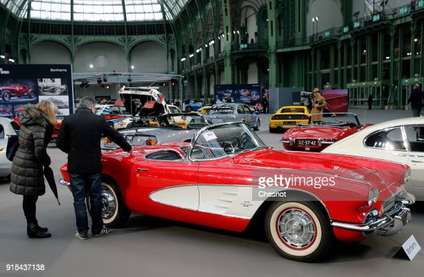 A couple look at a Chevrolet Corvette Roadster 1961 displayed during a press preview before a mass auction of vintage vehicles organised by Bonhams...