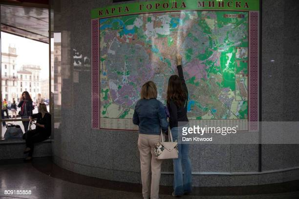 A couple look at a map of Minsk in the central train station on July 02 2017 in Minsk Belarus Independence Day also known as the Day of the Republic...