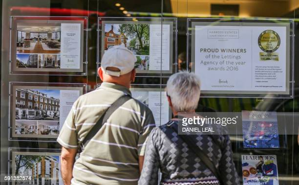 A couple look at adverts in the window of an estate agent in London on August 17 2016 From computers and cars to carpets and food Britain's decision...
