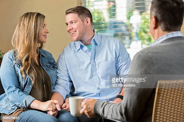 Couple look at one another during counseling session