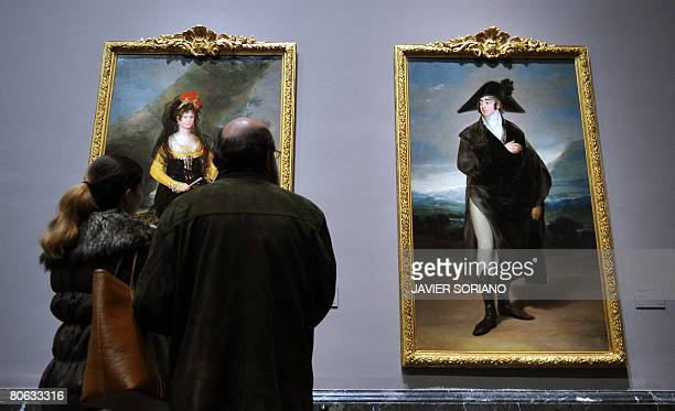 A couple look at portraits by Spanish artist Francisco Goya on show at the Prado museum as part of a new exhibition 'Goya in times of war' on April...