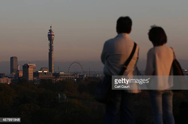 A couple look out at the BT Tower from Primrose Hill on October 28 2014 in London England Warmer than usual weather has seen London temperatures rise...