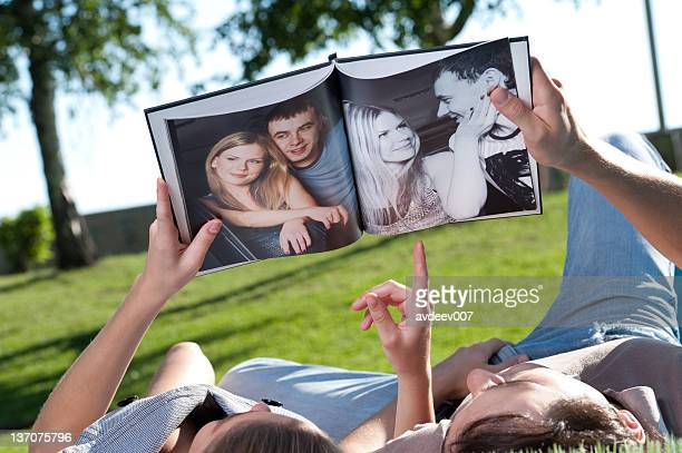 couple look photobook - photo album stock photos and pictures