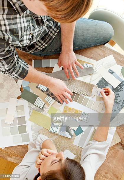 Couple looking a decorator swatches