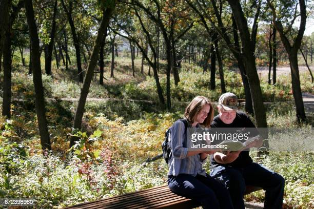 A couple looking at a book in Miller Woods at Indiana Dunes National Lakeshore