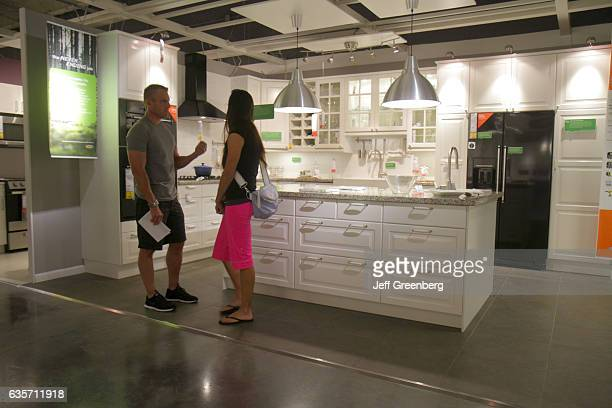 A couple looking at a kitchen retail display in IKEA