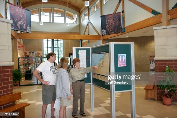 A couple looking at a map in Porter Visitors Center