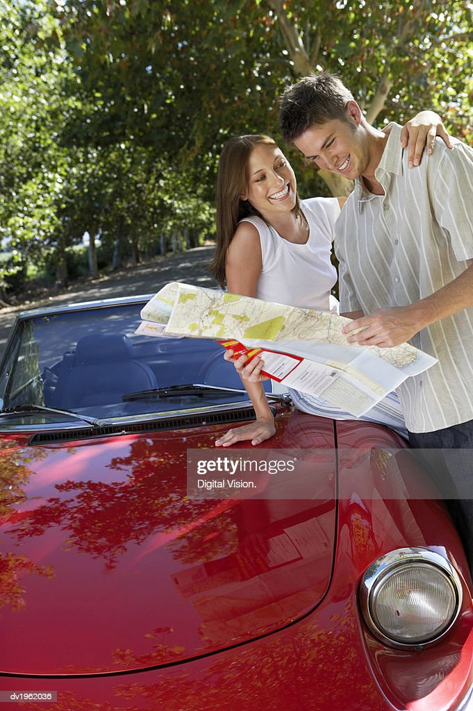 Couple Looking at a Map : Stock Photo