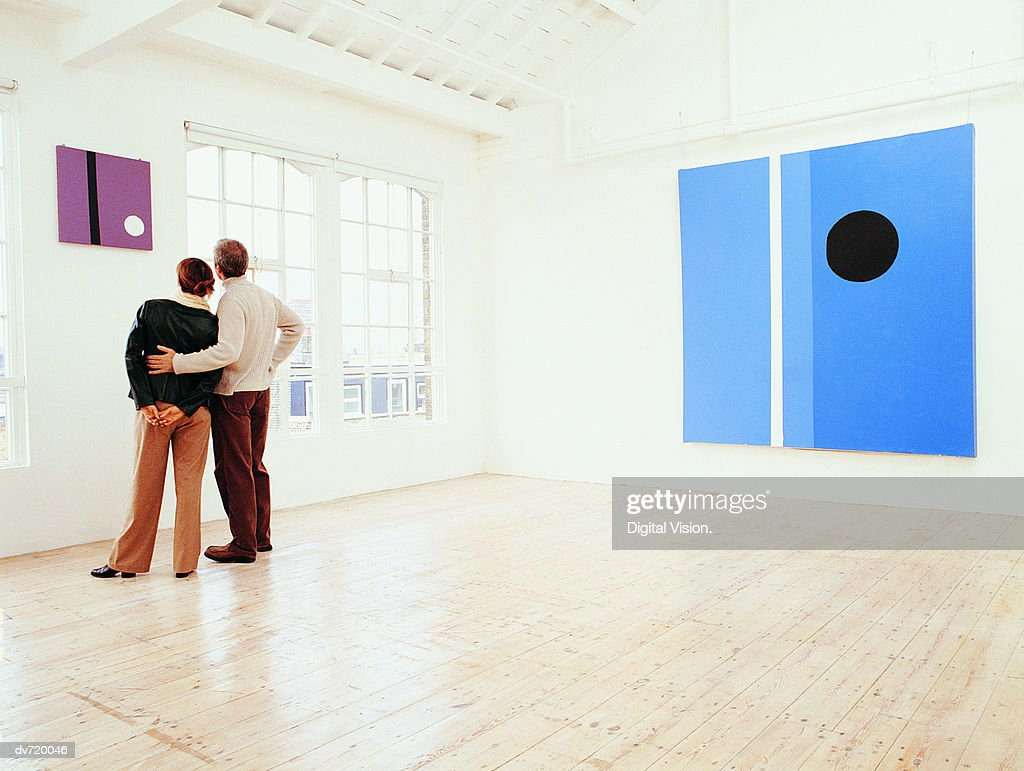 Couple Looking at a Painting in an Art Gallery : Stock Photo