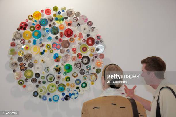 A couple looking at a piece of work called hypochondriac at Art Miami