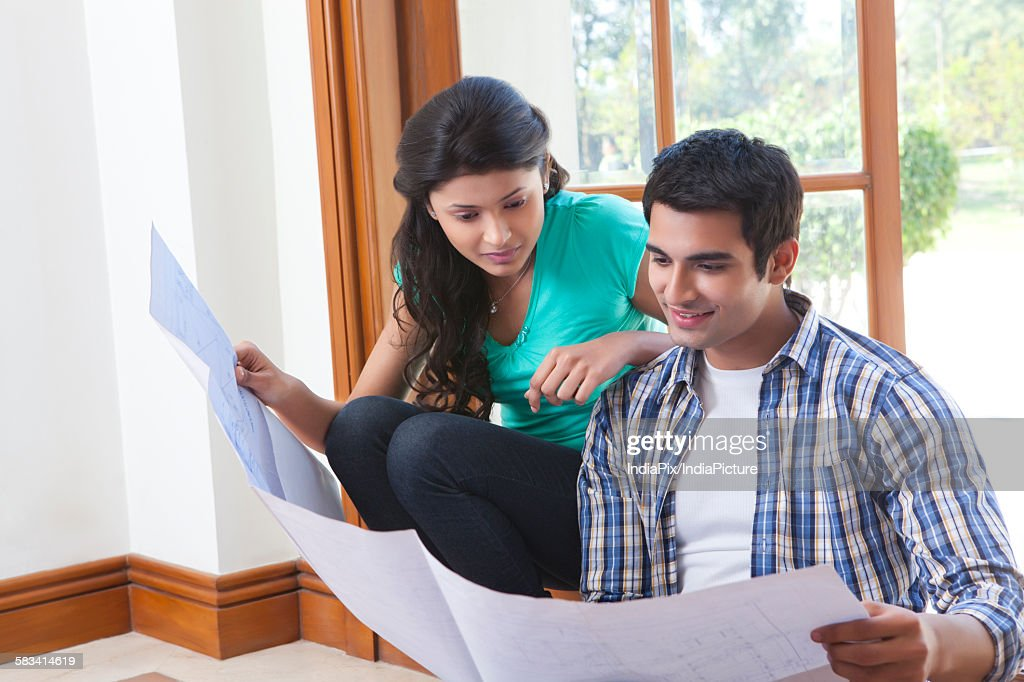 Couple looking at a sheet : Stock Photo