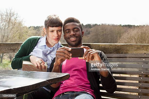 A couple looking at a smartphone together
