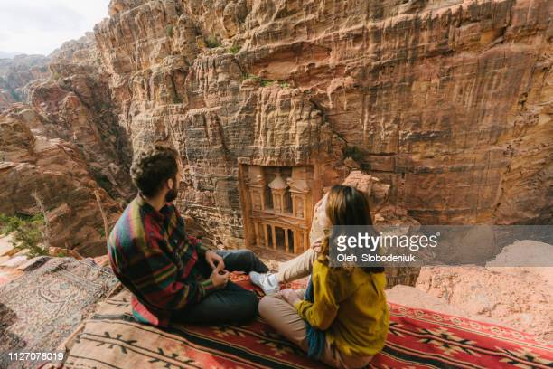 couple looking at al-khazneh in petra - jordan love stock pictures, royalty-free photos & images