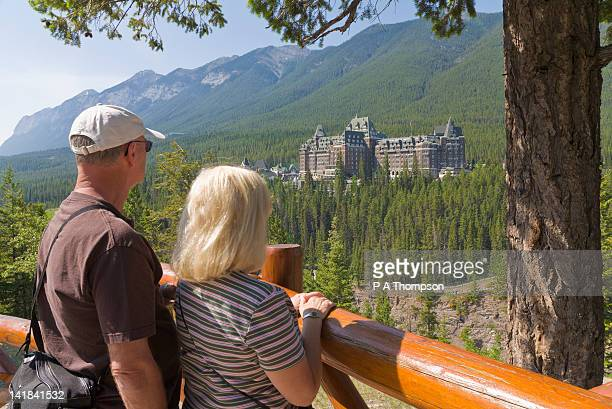 Couple looking at Banff Springs Hotel, Banff, Alberta, Canada MR