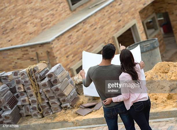 Couple looking at blueprints of their house