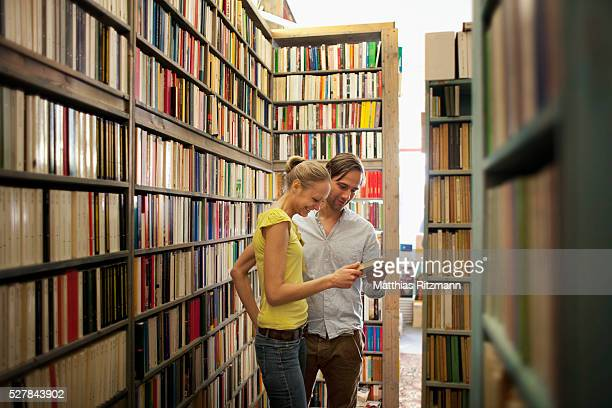 Couple looking at books in bookstore
