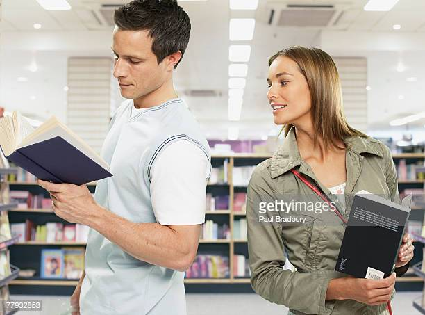 Couple looking at books in store