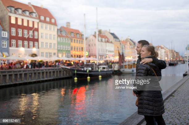 Couple looking at canal