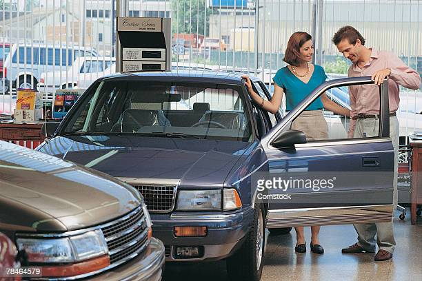 Couple looking at car
