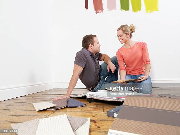 Couple looking at carpet samples.