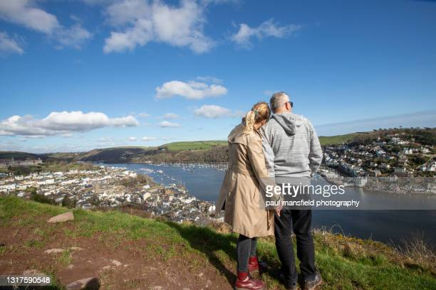 couple looking at dartmouth - passenger craft stock pictures, royalty-free photos & images