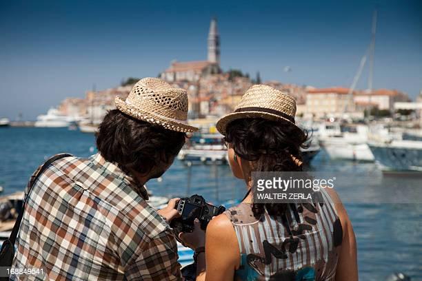 Couple looking at digital photos