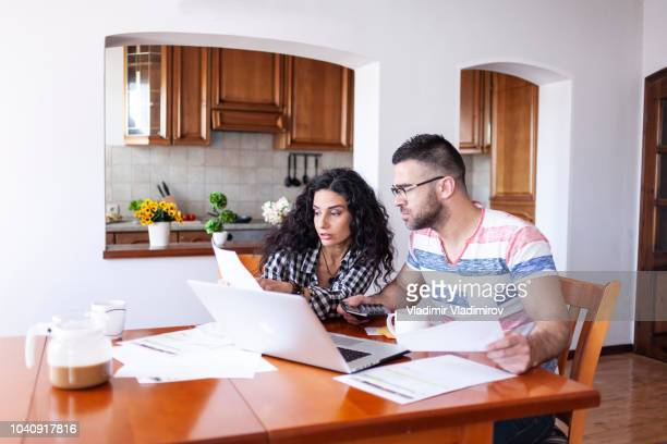 Couple looking at documents with financial bills