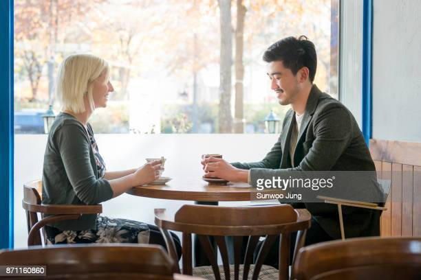 Couple looking at each other in coffee shop
