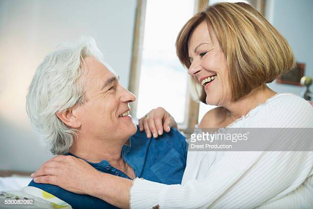 Couple looking at each other, smiling