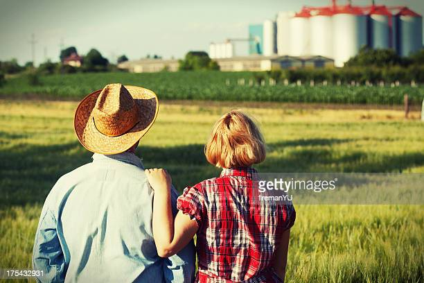Couple looking at farm