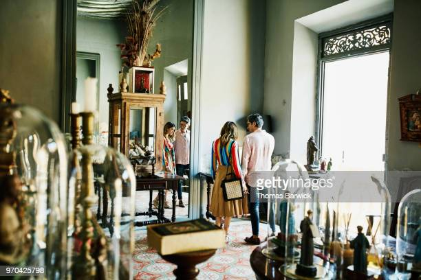 Couple looking at historical artifacts while shopping in boutique during vacation
