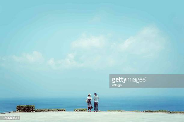 Couple looking at horizon and skyline