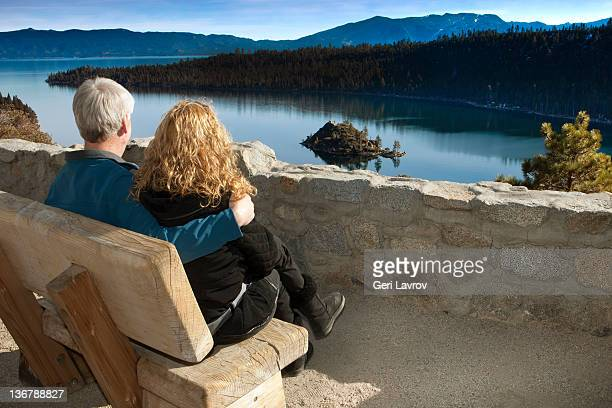couple looking at lake tahoe - emerald bay lake tahoe stock pictures, royalty-free photos & images