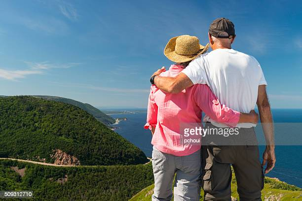 Couple looking at landscape, Skyline, Cabot trail, Cape Breton