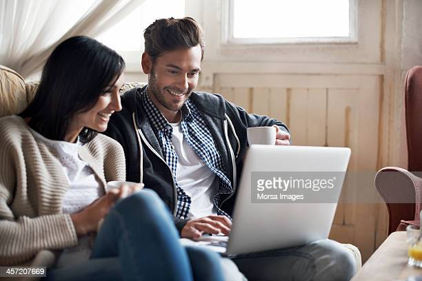 couple looking at laptop - couple relationship stock pictures, royalty-free photos & images