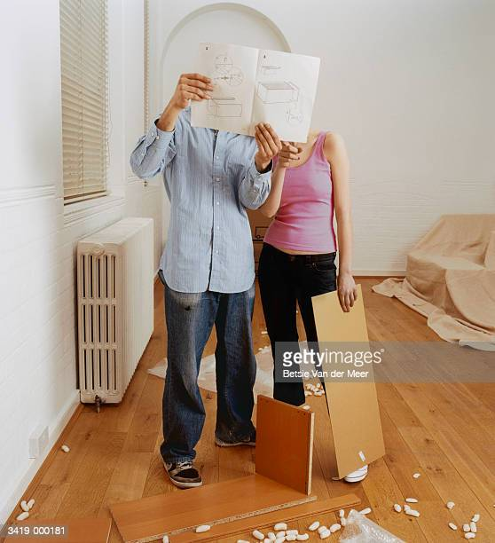 couple looking at manual - instruction manual stock photos and pictures