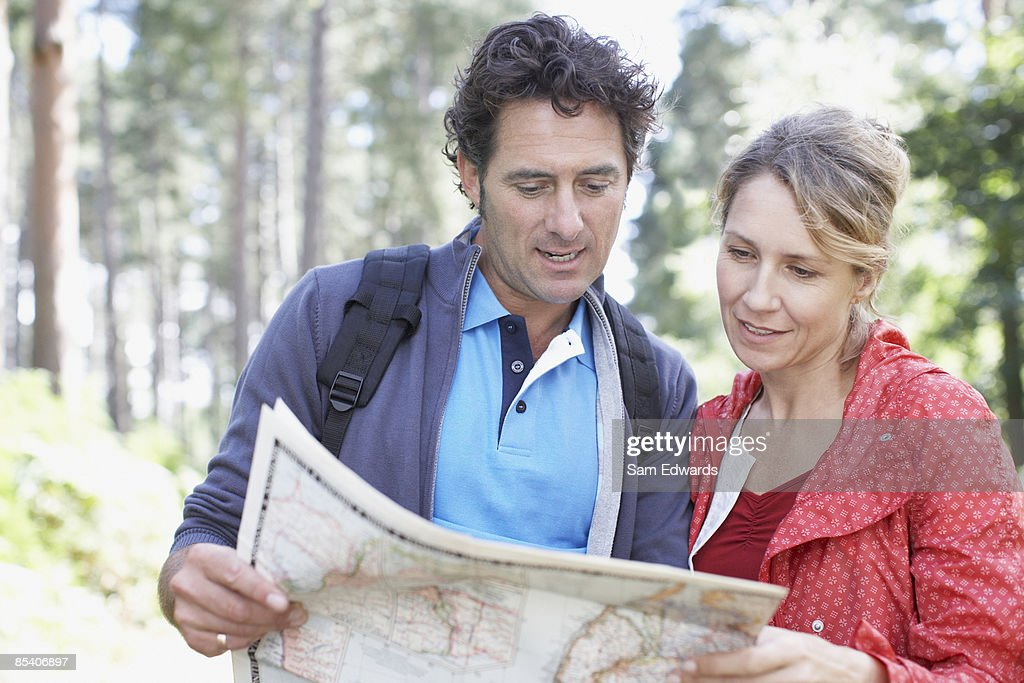 Couple looking at map : Stock Photo