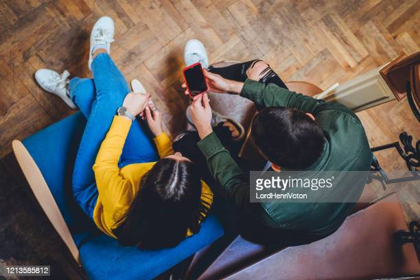 couple looking at mobile phone - casualty stock pictures, royalty-free photos & images