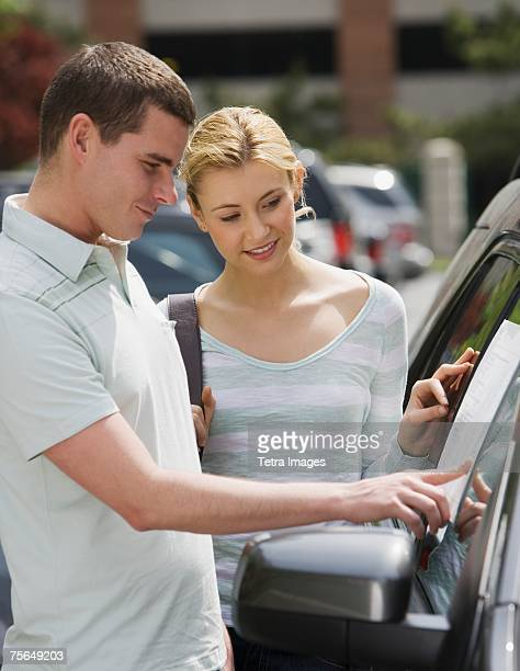 Couple looking at new car