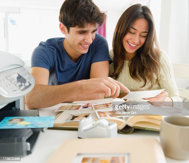 couple looking at photographs together