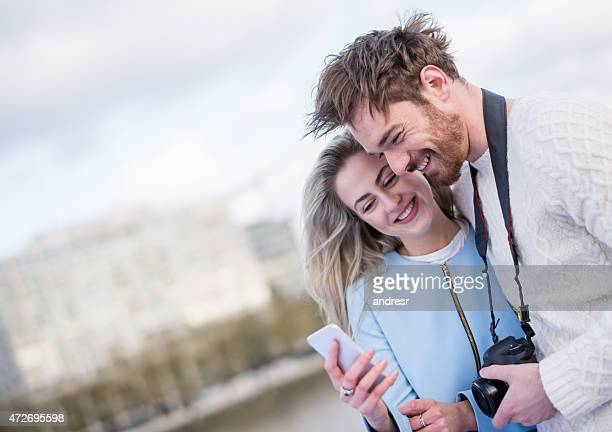 Couple looking at pictures on their cell phone