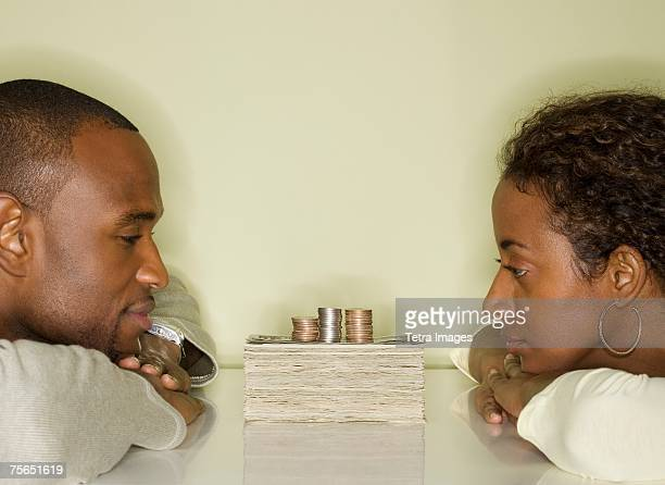 Couple looking at pile of money